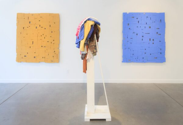 Left: All-One (Sun), Center: Heap, 2018, wood, found clothing, 17 x 90 x 18 inches, Right: All-One (Sky)