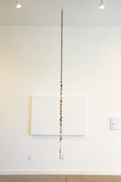 Holding On, 2018, metal chain, buttons, thread, 2 x 108 inches